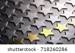 many stars in relief on black... | Shutterstock . vector #718260286