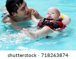 healthy family father teaching... | Shutterstock . vector #718263874