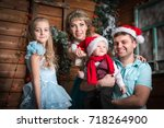 family in the room decorated... | Shutterstock . vector #718264900