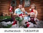 family in the room decorated... | Shutterstock . vector #718264918