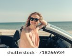 young woman drive a car on the...   Shutterstock . vector #718266934