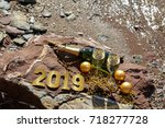 champagne on a stony beach by...   Shutterstock . vector #718277728