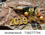 champagne on a stony beach by...   Shutterstock . vector #718277734