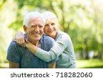 senior couple in park  | Shutterstock . vector #718282060
