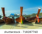 traditional thai boats on beach ...   Shutterstock . vector #718287760