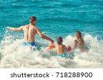 family of three people running... | Shutterstock . vector #718288900