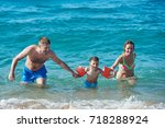 family of three people getting... | Shutterstock . vector #718288924