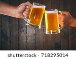 two friends toasting with... | Shutterstock . vector #718295014