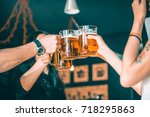 friends toasting with glasses... | Shutterstock . vector #718295863