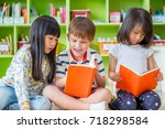 children sitting on floor and... | Shutterstock . vector #718298584