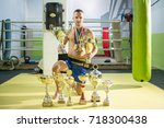 young boxer champion with many... | Shutterstock . vector #718300438