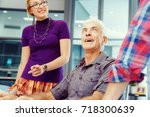 co workers working together | Shutterstock . vector #718300639