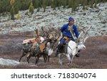 tsaatan family bringing... | Shutterstock . vector #718304074