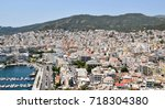 view to the port and downtown... | Shutterstock . vector #718304380