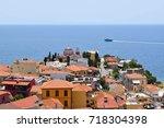 landscape of seaside town of... | Shutterstock . vector #718304398