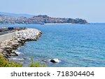 landscape of seaside town of... | Shutterstock . vector #718304404