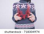 young brunette girl is... | Shutterstock . vector #718304974