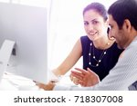 business people in modern office | Shutterstock . vector #718307008