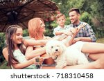 family playing guitar in their... | Shutterstock . vector #718310458