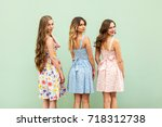 three young female friends in... | Shutterstock . vector #718312738