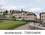 assisi building and archers  | Shutterstock . vector #718314604