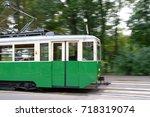 green historic tram in motion.... | Shutterstock . vector #718319074