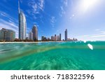 view from the water of surfers... | Shutterstock . vector #718322596