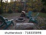 rustic fire pit | Shutterstock . vector #718335898