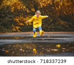 happy child girl with an... | Shutterstock . vector #718337239