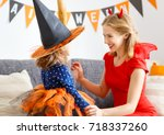 family mother and child girl... | Shutterstock . vector #718337260