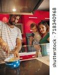 lovely family in kitchen... | Shutterstock . vector #718340968
