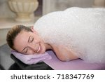 young woman covered with foam... | Shutterstock . vector #718347769