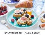 bruschettas with fresh ripe... | Shutterstock . vector #718351504