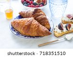 french croissants on the plate... | Shutterstock . vector #718351510