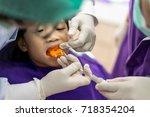 asian girl met the dentist for... | Shutterstock . vector #718354204