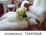 Stock photo white roses wedding bouquet on a fur 718355068