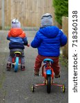 two boys learning to ride... | Shutterstock . vector #718360138