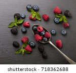 ripe and sweet berries on... | Shutterstock . vector #718362688