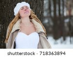 young caucasian bride in white... | Shutterstock . vector #718363894