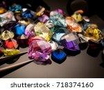 jewel or gems on black shine... | Shutterstock . vector #718374160