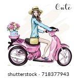 beautiful young girl in hat... | Shutterstock .eps vector #718377943