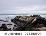 rocks in the atlantic ocean. an ... | Shutterstock . vector #718380904
