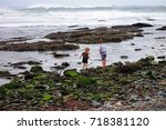 two boys playing on the edge of ... | Shutterstock . vector #718381120