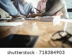 business colleagues meeting to... | Shutterstock . vector #718384903