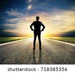 businessman walks on an unknown ... | Shutterstock . vector #718385356