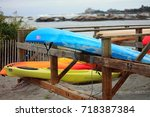 a couple of colorful kayaks on... | Shutterstock . vector #718387384