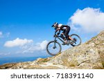 a man is riding enduro bicycle  ... | Shutterstock . vector #718391140
