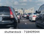 traffic jam with row of cars on ... | Shutterstock . vector #718409044