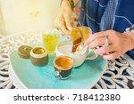 coffee barista pouring black... | Shutterstock . vector #718412380