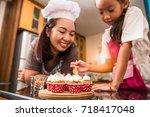 asian mother and daughter enjoy ... | Shutterstock . vector #718417048